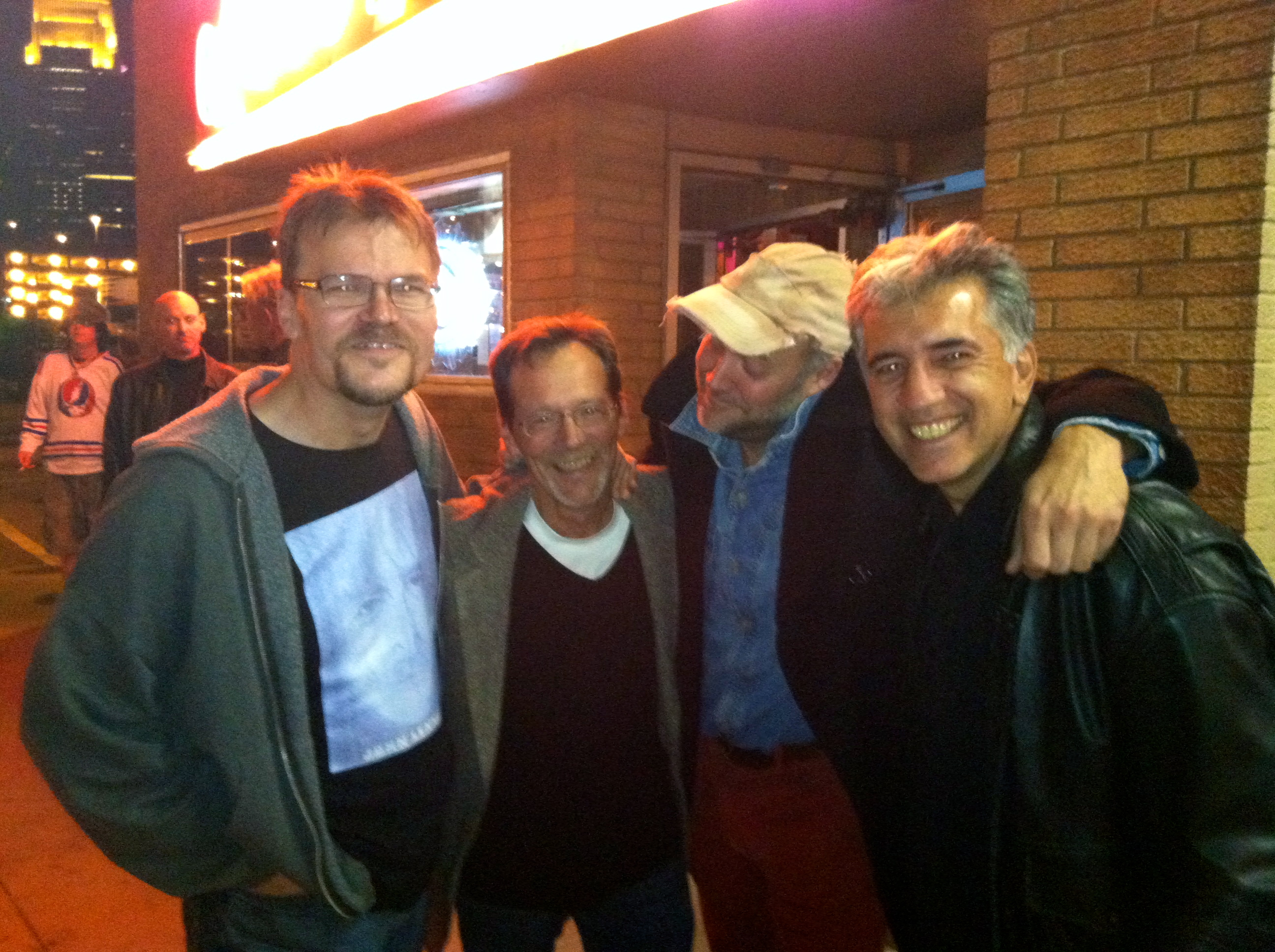 The Oarsmen, left to right, Kevin Featherly, Mike Olk, Barron Whittet and Scott Maida, outside Lee's Liquor Lounge, where the benefit will be held. Photo by Dave Wildermuth.