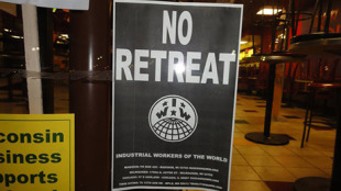 Sign in a store window during the 2012 labor protests In Madison, Wis. Photo: Kevin Featherly.
