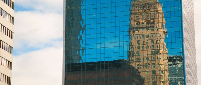 A distorted Foshay Tower is reflected from the Campbell Mithun Tower in Downtown Minneapolis. Photo: Kevin Featherly.