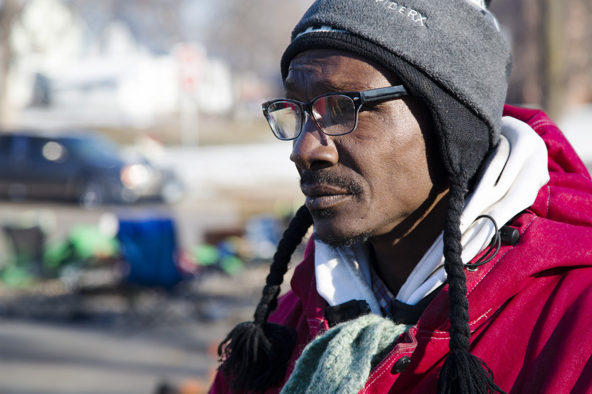 "Merrill Champion stands outside the 4th Minneapolis Police precinct on Nov. 27, as part of the ongoing ""Justice 4 Jamar"" protests. Photo: Kevin Featherly"
