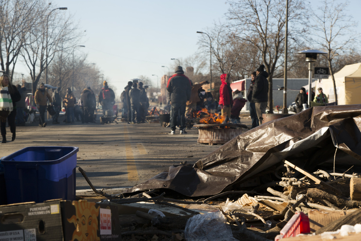A makeshift barricade marks the space claimed by protesters outside  the 4th Police Precinct, Minneapolis, Minn., following the police shooting of Jamar Clark. Photo: Kevin Featherly